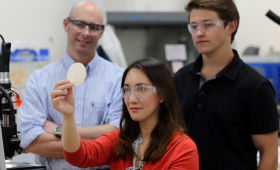 image of researchers holding 4D printed material