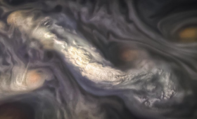 High-altitude cloud formation surrounded by swirling patterns in the atmosphere of Jupiter's North North Temperate Belt region.