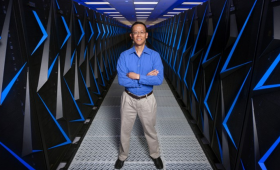 Barry Chen among racks of supercomputers