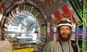 Scientist in front of the CMS detector