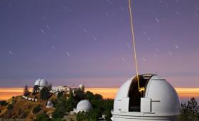 The Lick Observatory's Laser Guide Star forms a beam of glowing atmospheric sodium ions.