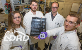 Scientists hold 3D-printed device