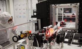 Researcher inspects laser equipment