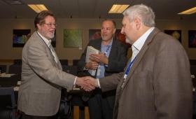 Lawrence Livermore National Laboratory Director Bill Goldstein (right) shakes hands with San Francisco 49ers chairman John York