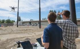 Researchers testing drones at enclosure