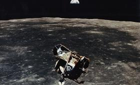 Apollo 11 moon lander, moon in background, earth on horizon