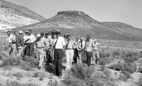 B&W photo of men walking at Nevada Test Site