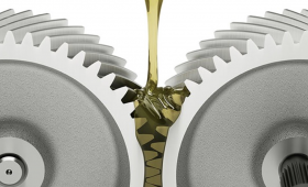 two gears moving with pouring oil