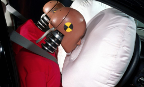 Two test dummies crashing into air bags