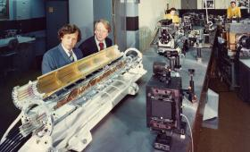 Carl Haussmann and John Emmett, working on lasers in 1973.