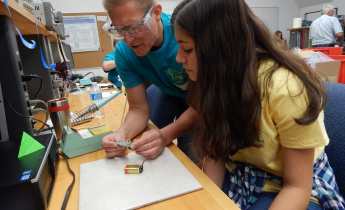 LLNL volunteer teaching a student