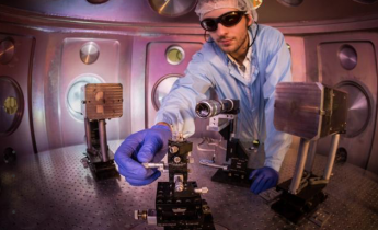 Researcher working with Jupiter laser